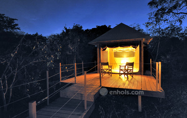 Rhino-river-camp-meru-tent-exterior-night